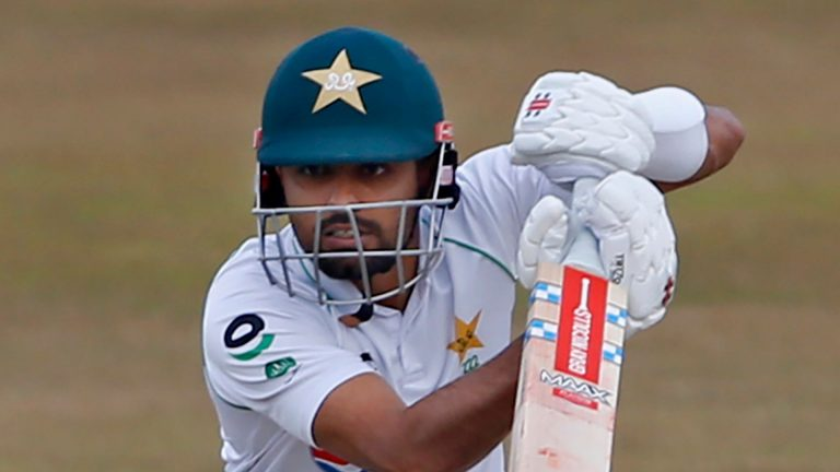 Babar leads Pakistan recovery before rain